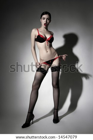 a surprised lady standing in sexy lingerie - stock photo