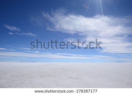 a surreal landscape of infinite view of salt flat in uyuni, bolivia - stock photo