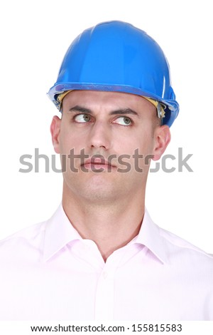 A suspicious-looking engineer - stock photo