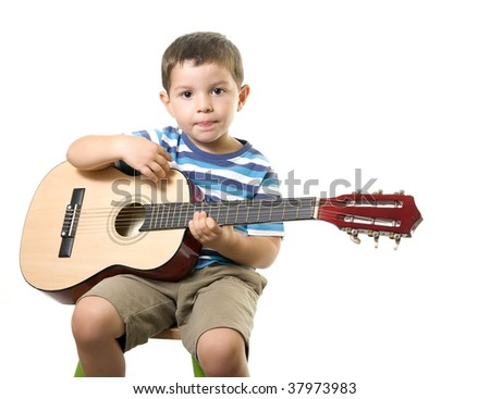 A sweet boy playing guitar ( isolated on white ) - stock photo
