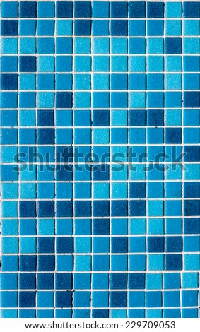 A swimming pool floor tiles on a sunlight - stock photo