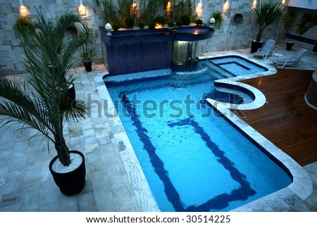 A swimming pool with a cascade - Landscape Architecture - stock photo
