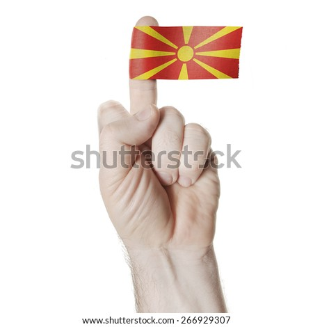 A symbol of challenge: the middle finger with the flag of Macedonia - stock photo