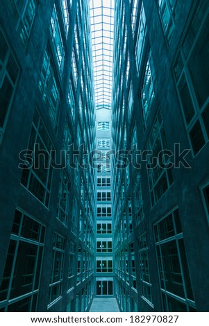 A symmetrical hallway of windows - stock photo