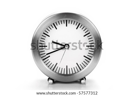 A table clock isolated in white background - stock photo