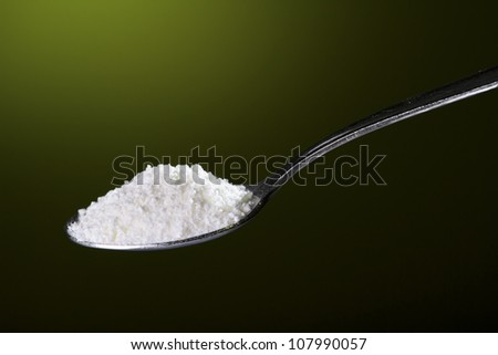 a tablespoon of salt mineral supplement for athletes - stock photo