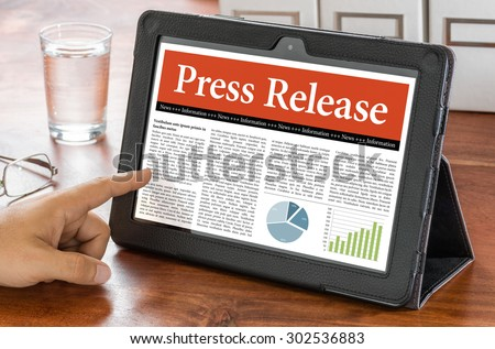 A tablet computer on a desk - Press Release - stock photo