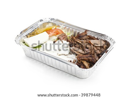 A take away plate with gyros meat and salad - stock photo