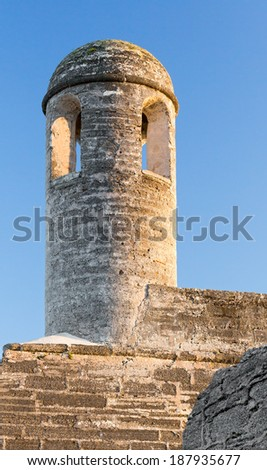 A tall bell tower stands on on corner of the Castillo de San Marcos, a seventeenth century Spanish fort in St. Augustine, Florida. - stock photo