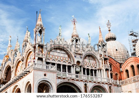 A tall building with lots of steeples and large domes. - stock photo