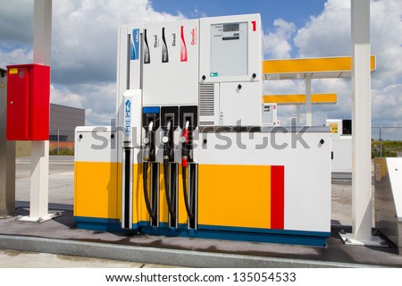 a tank station for large quantities with the sky as background - stock photo