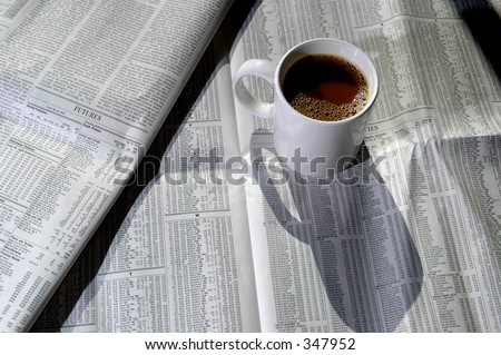a tasty cup of coffee with the stock charts - stock photo