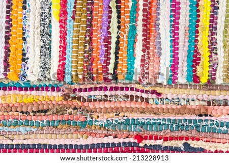 A tatty rug made of re-used fabric - stock photo