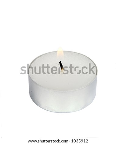 A tea light isolated on white with clipping path. - stock photo