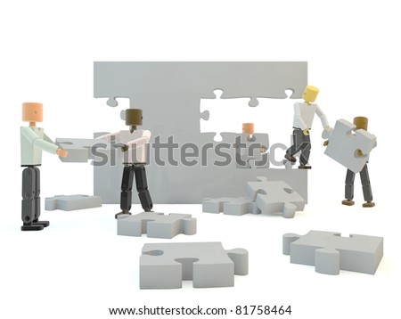A team building a grey wall against a white isolated background - stock photo