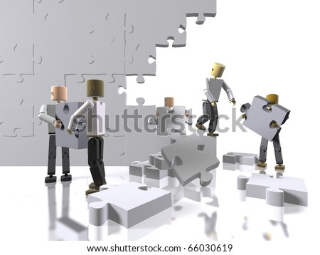A team collaborating to build a puzzle - stock photo