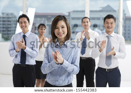 A team of business people celebrating. Multi ethnic business team. - stock photo
