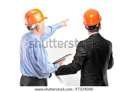 A team of construction workers with orange helmets posing isolated on white background - stock photo