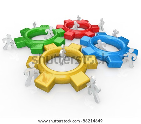 A team of illustrated people work together to push several colored gears into a functioning machine to symbolize the synergy and partnership necessary to achieve a major goal - stock photo