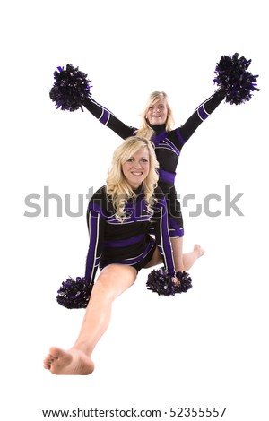 A team of two cheerleaders.  One is doing the splits and the other is behind her on her knees with her pom poms up in the air. - stock photo