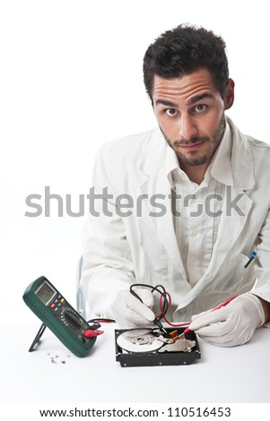 A technician repairing an hard disk with a tester - stock photo