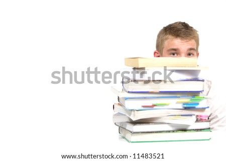 A teen age student over whelmed with home work - stock photo