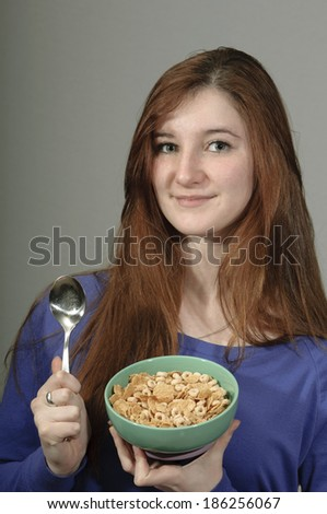A Teen and a Bowl Full of Cereal - stock photo