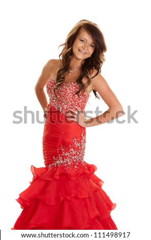 A teen girl in her formal dress posing with a smile on her face. - stock photo