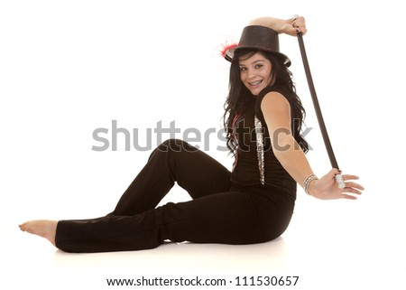 A teen girl with a smile on her face holding her cane behind her back with a smile on her face. - stock photo