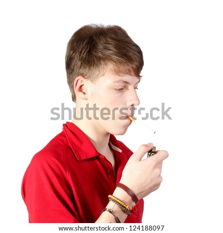 a teenage boy trying to smoke a cigarette against white background - stock photo