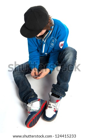 a teenage boy with a telephone - stock photo