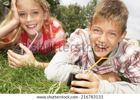 A teenage couple in a park. - stock photo