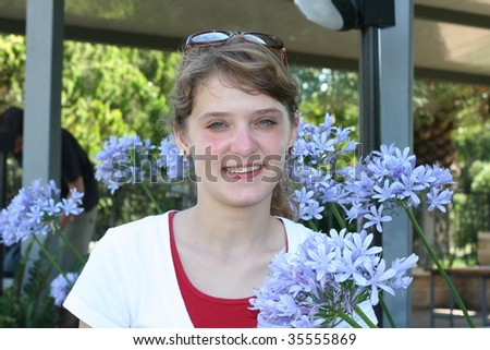 A teenage girl with flowers - stock photo