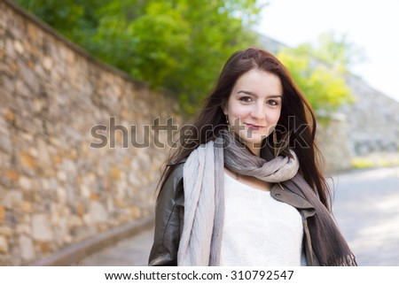 A Teenage girl  with her handbag having fun - stock photo