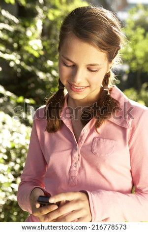 A teenage girl with her mobile phone. - stock photo