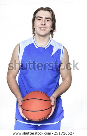 A teenager basketball player over a white background - stock photo