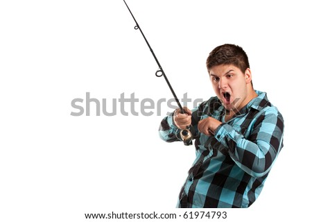 A teenager is surprised as he reels in a big fish.  Isolated over white in studio with plenty of negative space. - stock photo