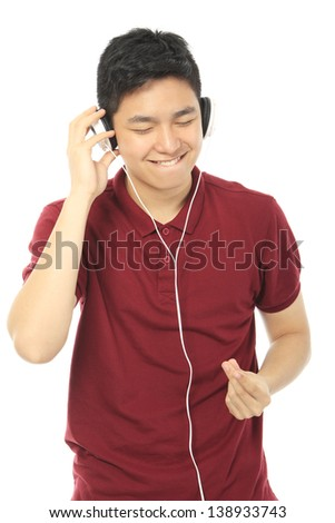 A teenager wearing headphones and enjoying the music  - stock photo