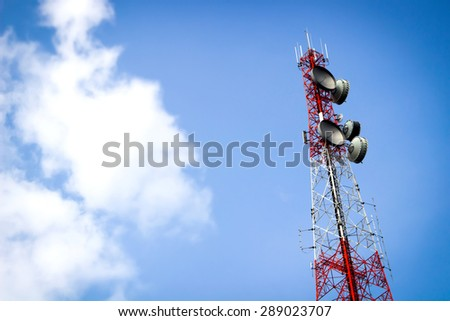 A telecommunication tower and blue sky - stock photo