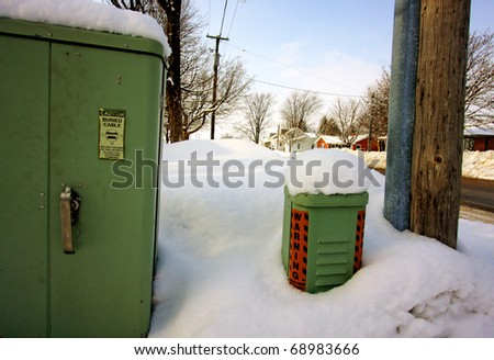 a telephone box covered in snow - stock photo