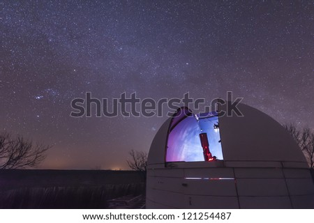 A telescope sits in an open observatory dome at the 3RF Astronomy Campus near Crowell, Texas. - stock photo