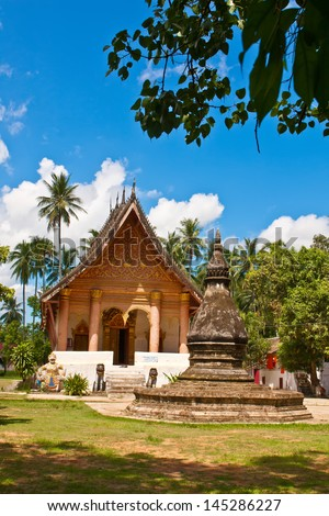 """A temple """"Wat Aham"""" with blue sky in Luang Prabang, the world heritage town - stock photo"""