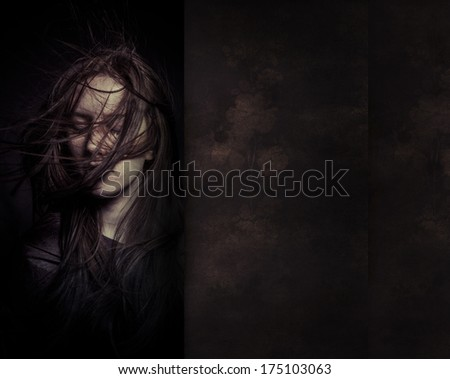 A tender portrait of a dreamy girl with eyes closed,  perfect skin and long hair, developing - stock photo