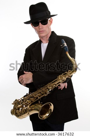 A Tenor Sax Player Dressed in Black - stock photo