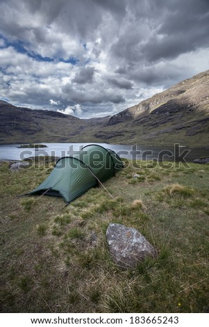A tent in the Scottish Higlands. At the foot of the cuillin Mountain Range at the Isle of Skye. Adventure waiting.... - stock photo
