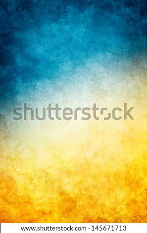 A textured vintage paper background with a dark blue to golden yellow gradient. - stock photo