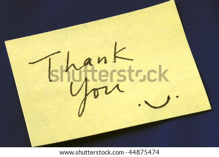 A Thank You note isolated on dark blue background - stock photo