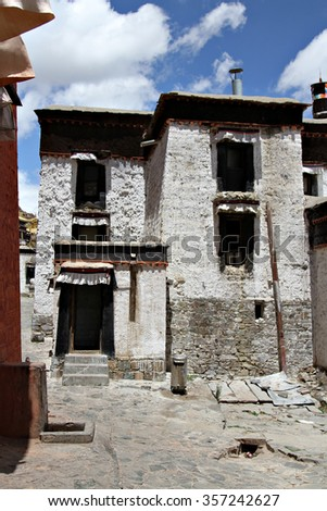A the front facade of a house in a rural village in the Himalayas, Tibet. - stock photo