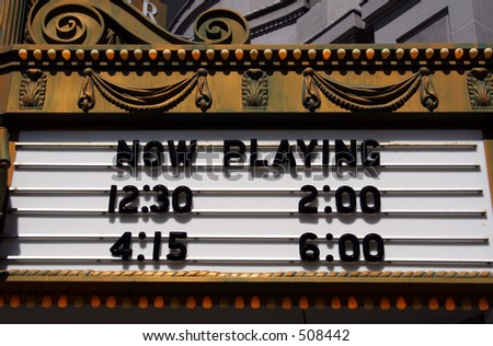 A theater marquee with show times. - stock photo