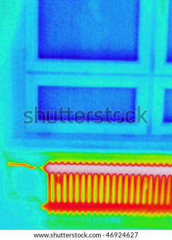 a thermography or thermal image of a room with a window and a radiator - stock photo